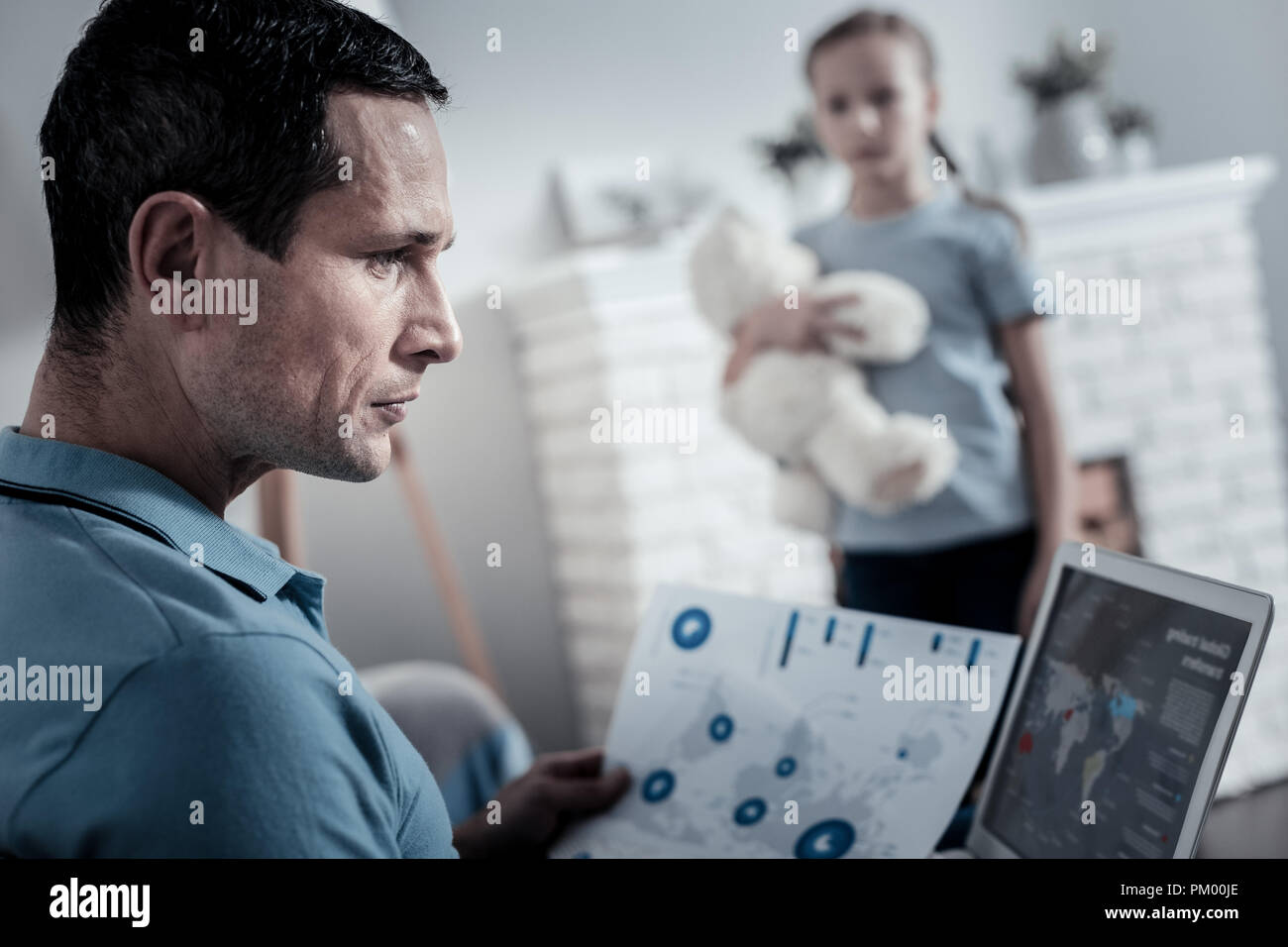 Concentrated man working at home - Stock Image