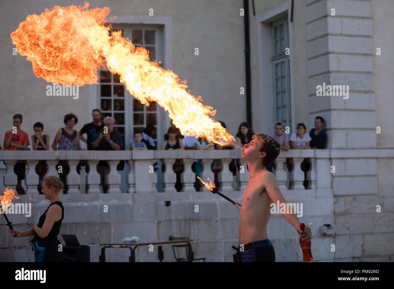Sassenage castle, Isere, France - September 15 2018 : European Heritage Day, Young fire breather spitting flames. - Stock Image