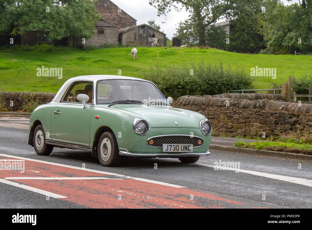 1991 green Nissan Classic, vintage, veteran, cars of yesteryear, restored collectibles at Hoghton Tower Class Cars Rally, UK - Stock Image