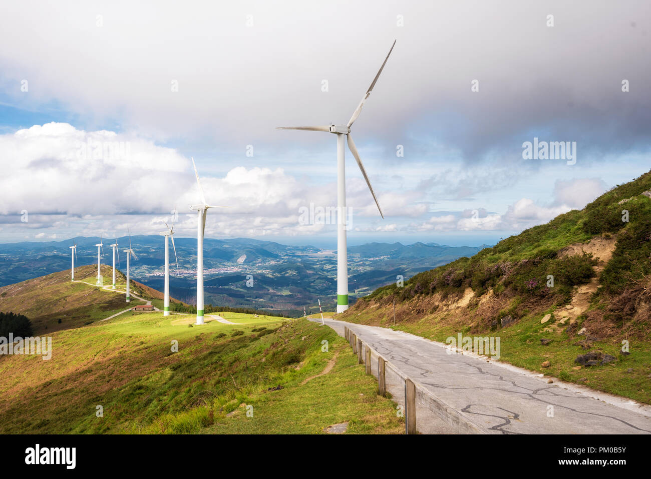 Renewable energy. Wind turbines, eolic park in scenic landscape of basque country, Spain. - Stock Image
