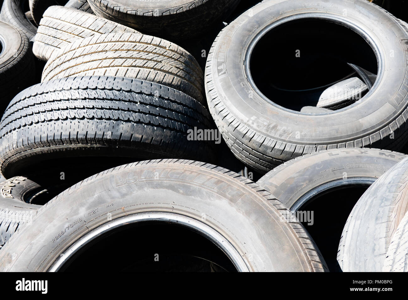 A pile of used worn discarded tires for recycling in Upstate New York, USA. - Stock Image
