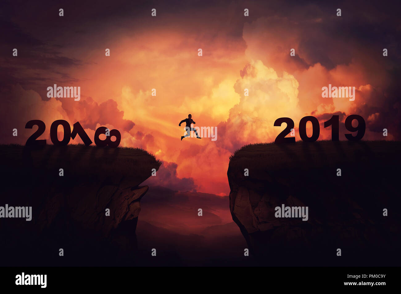 Surreal view as a businessman jump over a chasm obstacle between 2018 and 2019 years. Self overcome new year concept, way to win and success over suns - Stock Image