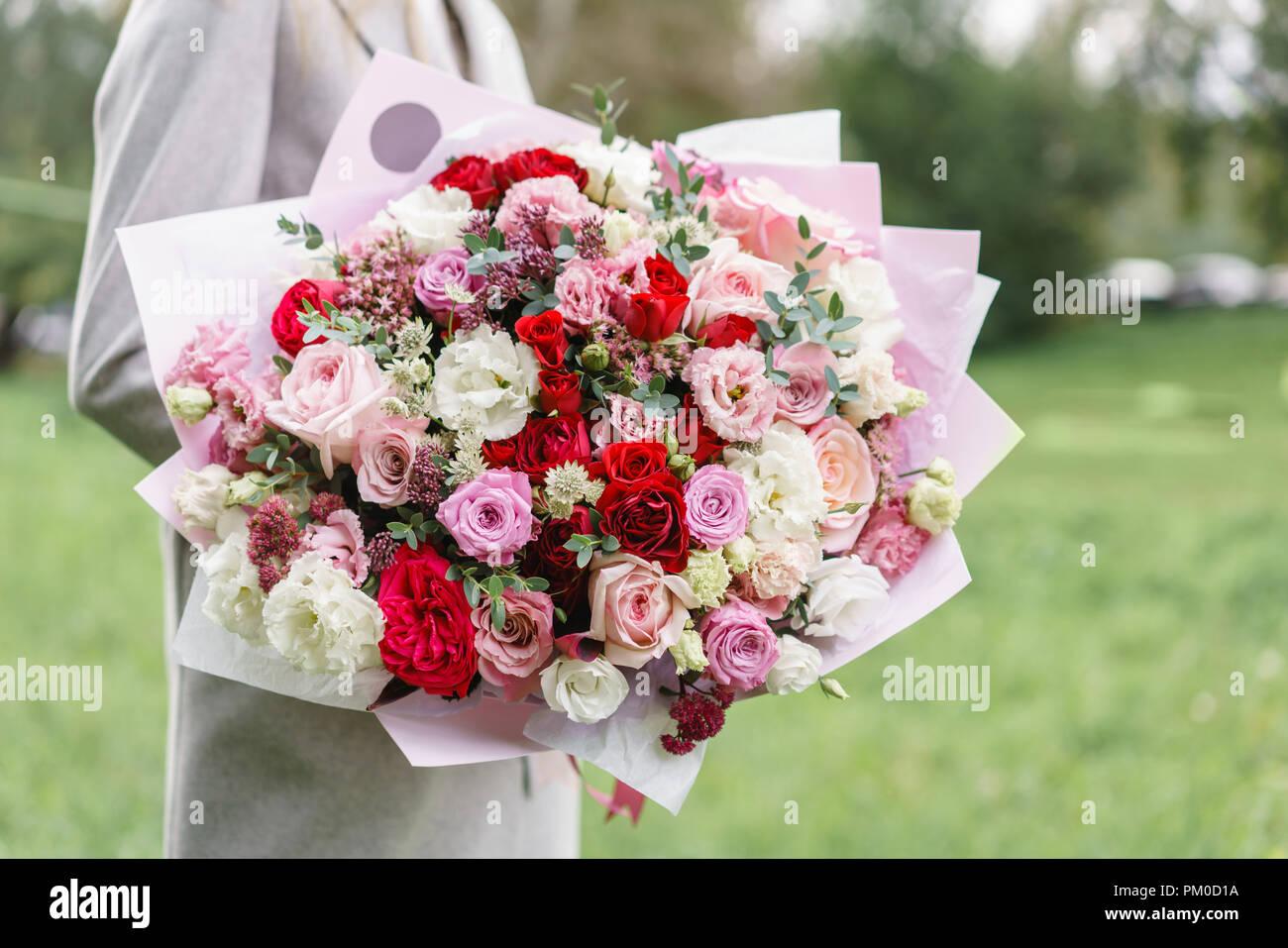 Lovely Woman Holding A Beautiful Autumn Bouquet Flower Arrangement