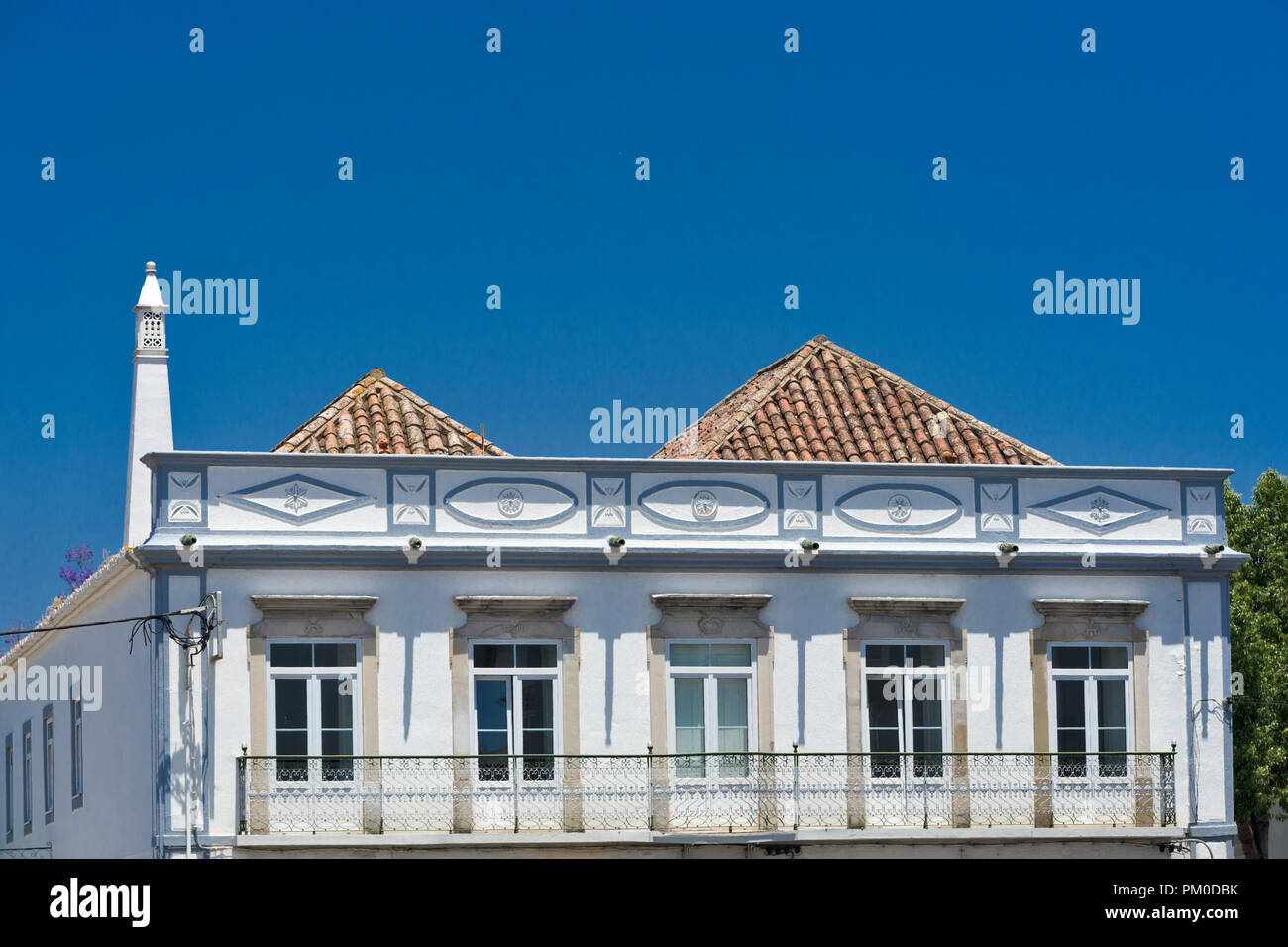 Tavira, Algarve, Portugal, the roofs with four slopes show a strong oriental influence by their architecture - Stock Image