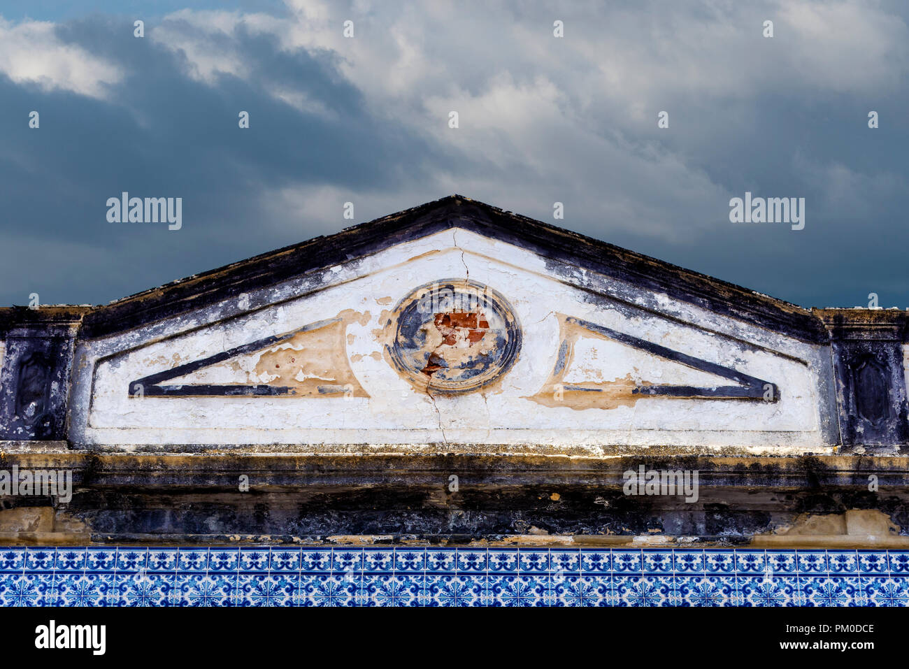 decrepit pediment on a house in Tavira Algarve Portugal - Stock Image