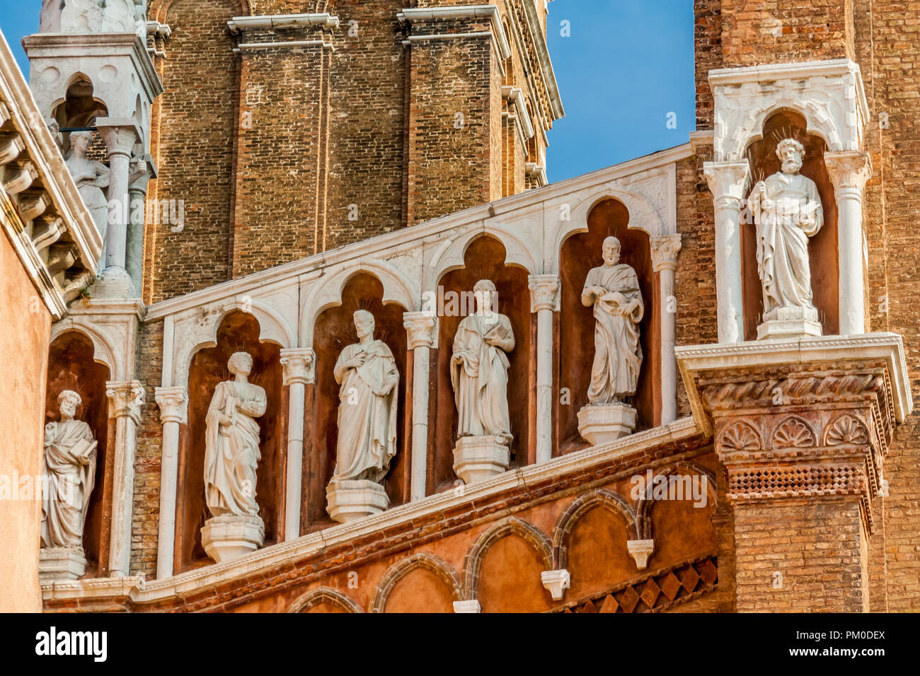 Statues on the facade of the Church of Madonna de l'Orto, Venice, Italy. - Stock Image