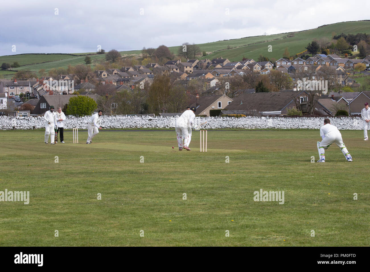 Local village cricket match being played in Yorkshire, England U.K. - Stock Image