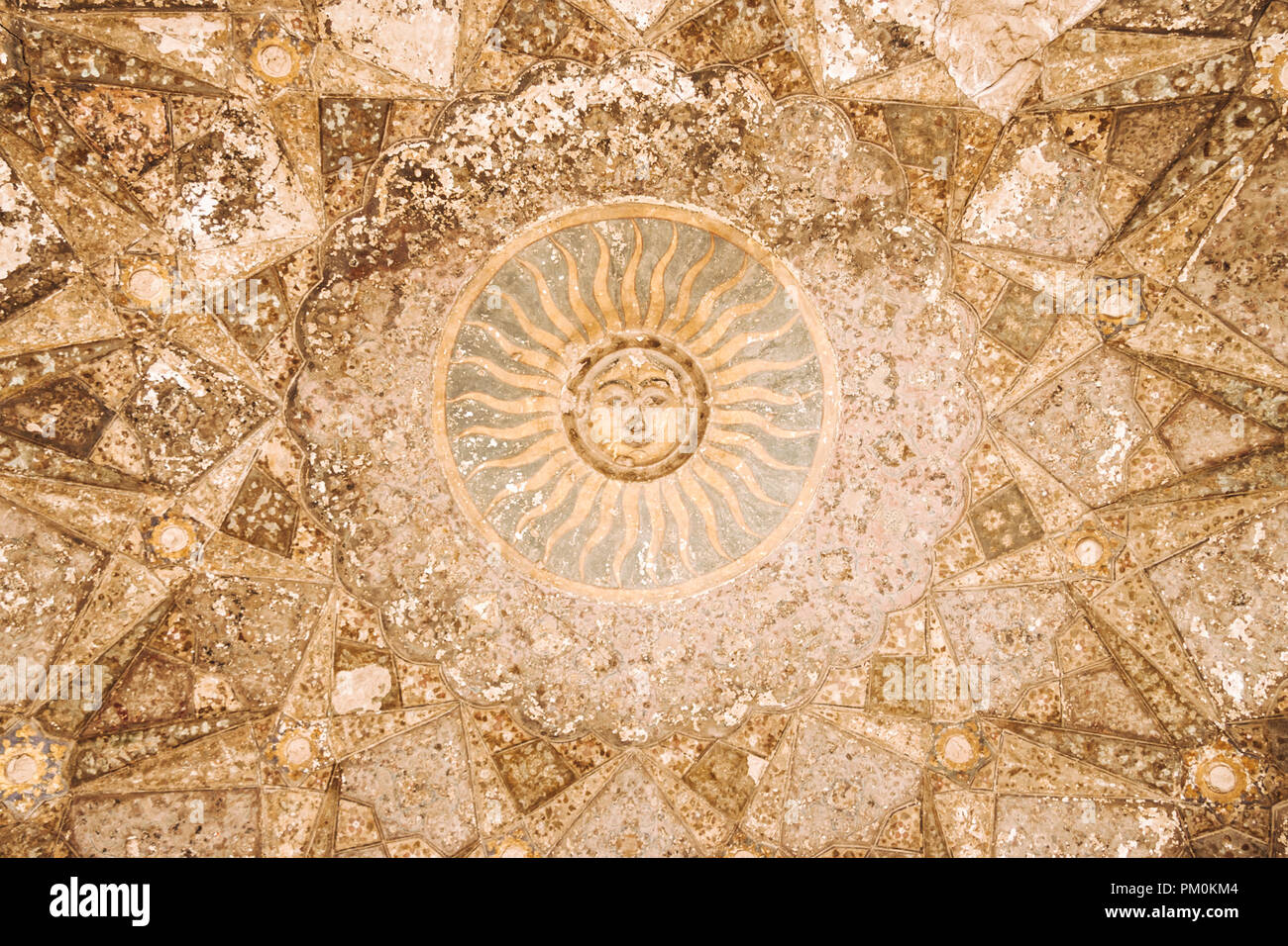Lahore, Punjab, Pakistan, South Asia : Sun painting at an ornate ceiling inside the Mughal era Shahi Qila or Lahore Fort. Stock Photo