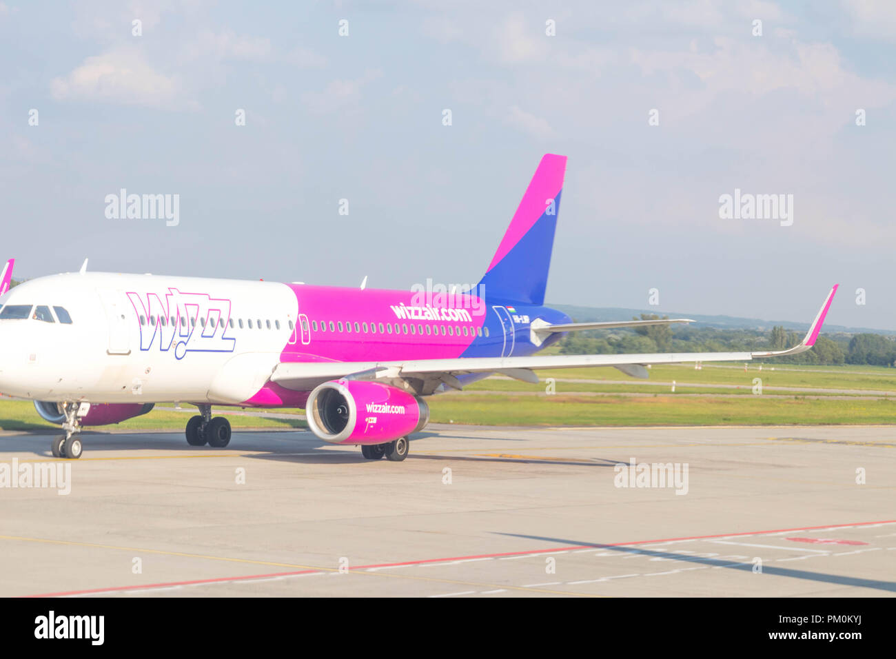 Wizz W!zz air airline airplane airport - Stock Image