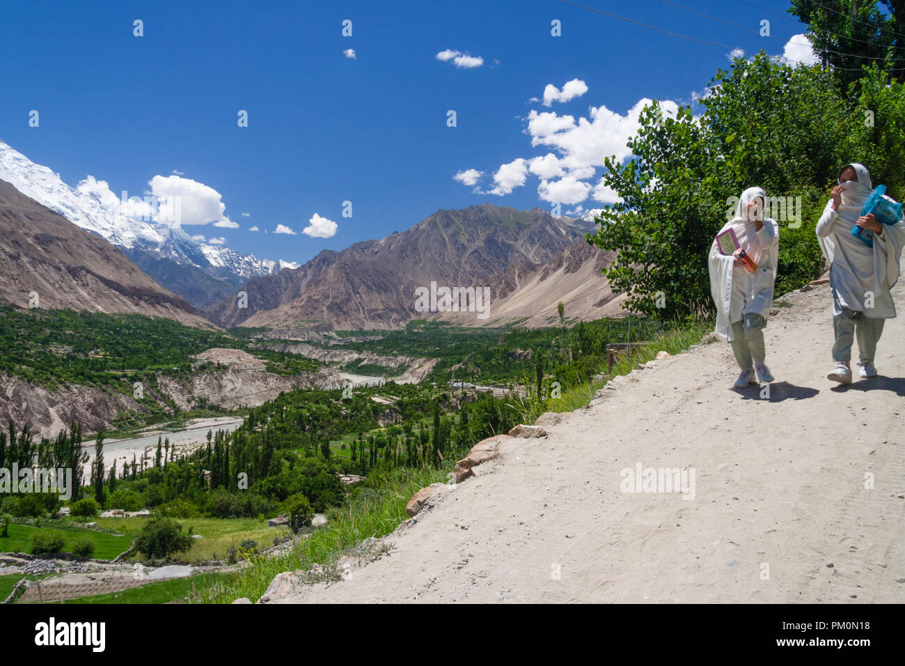 Karimabad, Hunza Valley, Gilgit-Baltistan, Pakistan : Two school girls walk back home from the school at Karimabad (formerly Baltit) the capital of th - Stock Image