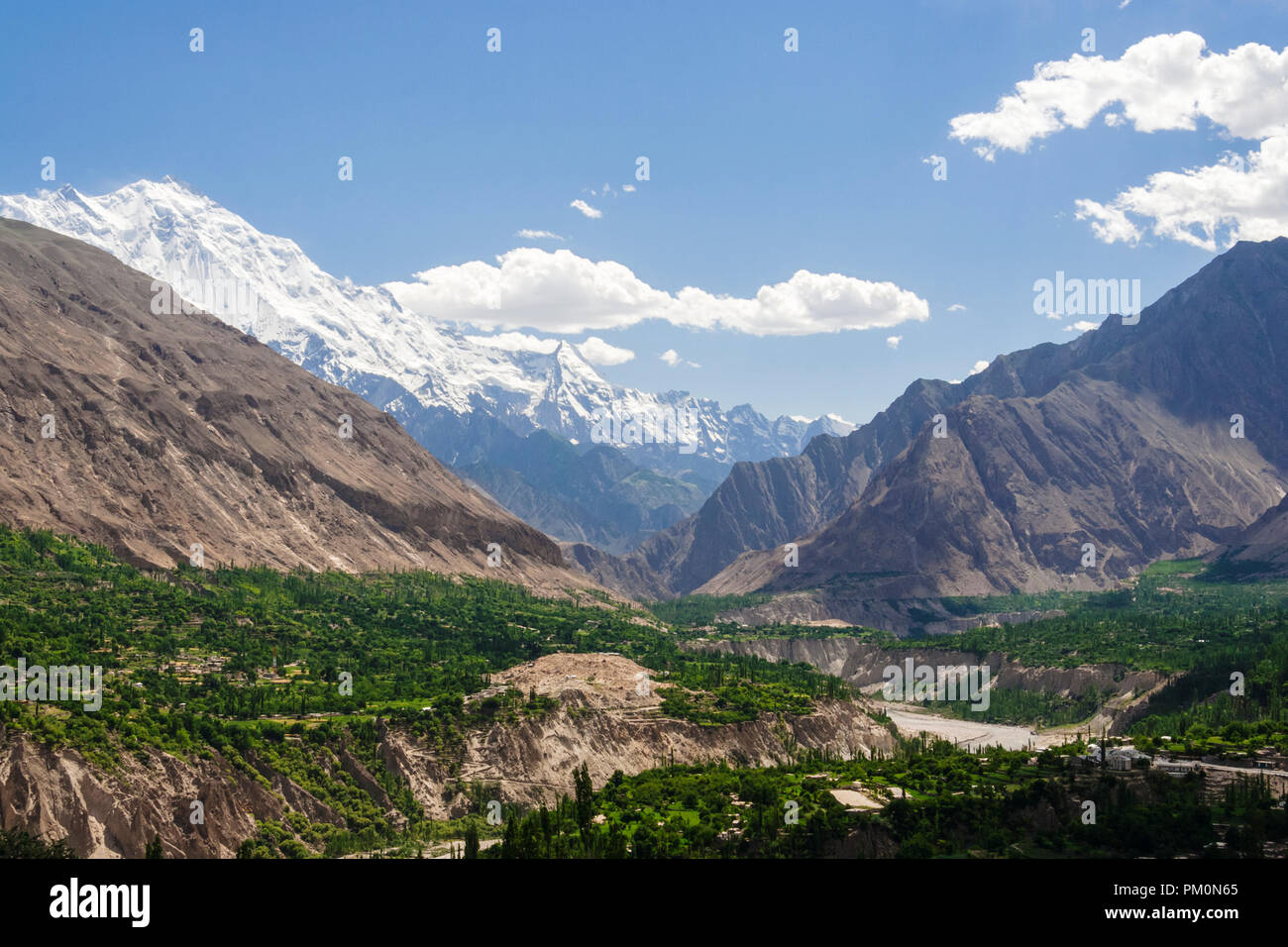 Karimabad, Hunza Valley, Gilgit-Baltistan, Pakistan : Rakaposhi mountain and Hunza Valley in the Karakoram range. At 7,788 m (25,551 ft) Rakaposhi is  - Stock Image