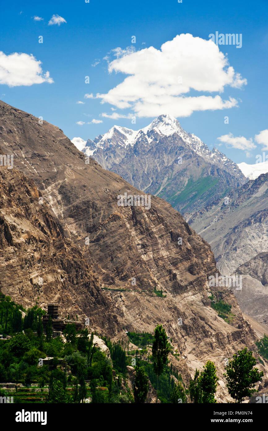 Altit Fort and Karakoram Range, Pakistan - Stock Image