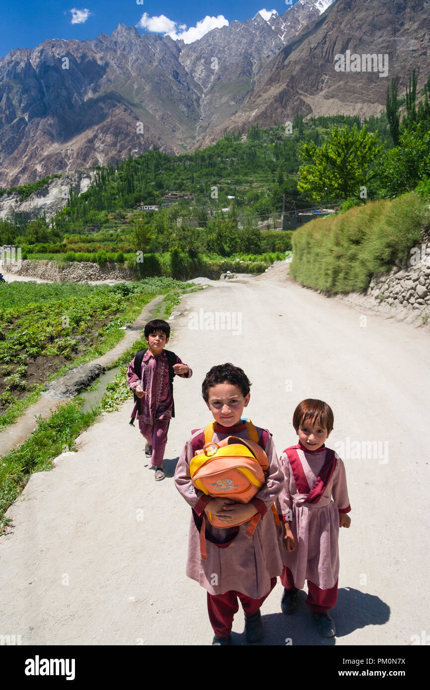 Karimabad, Hunza Valley, Gilgit-Baltistan, Pakistan : School children walk back home at Altit village from the school at Karimabad (formerly Baltit) t - Stock Image