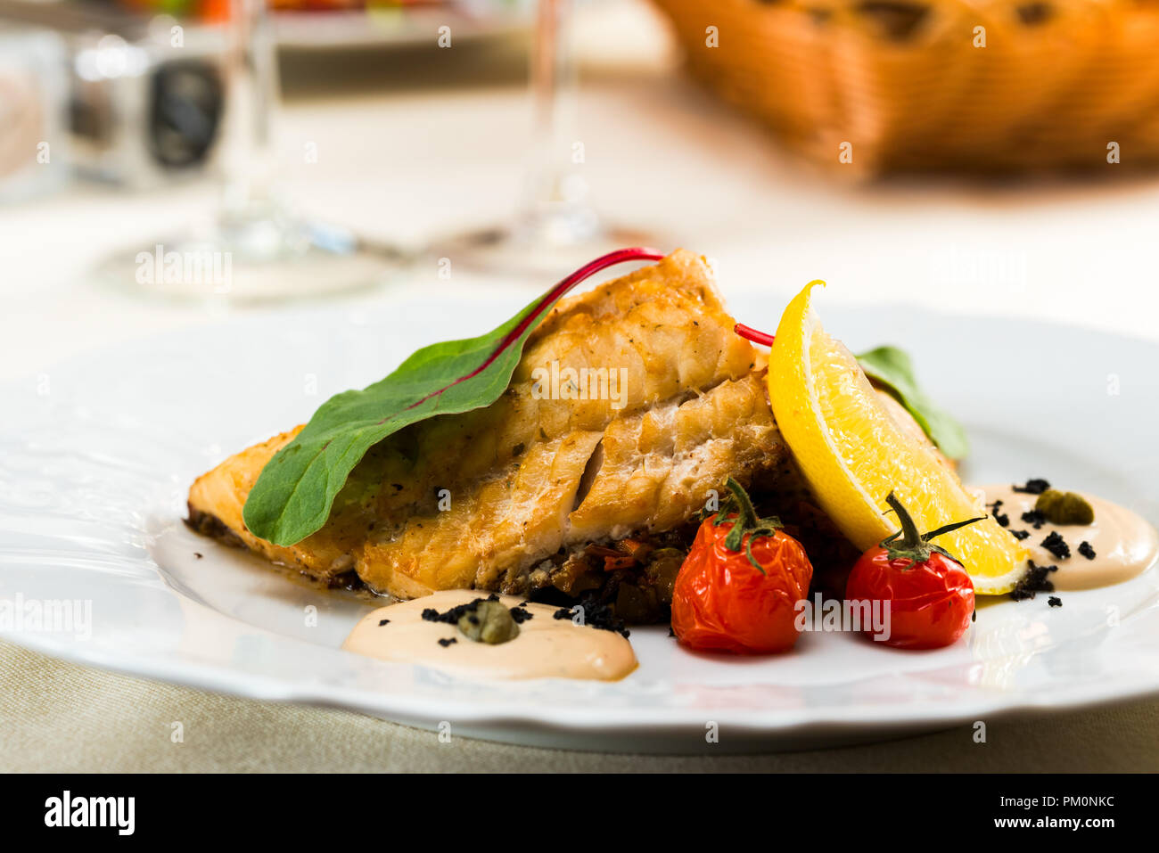 fish fillet fried in sause with vegetables Stock Photo