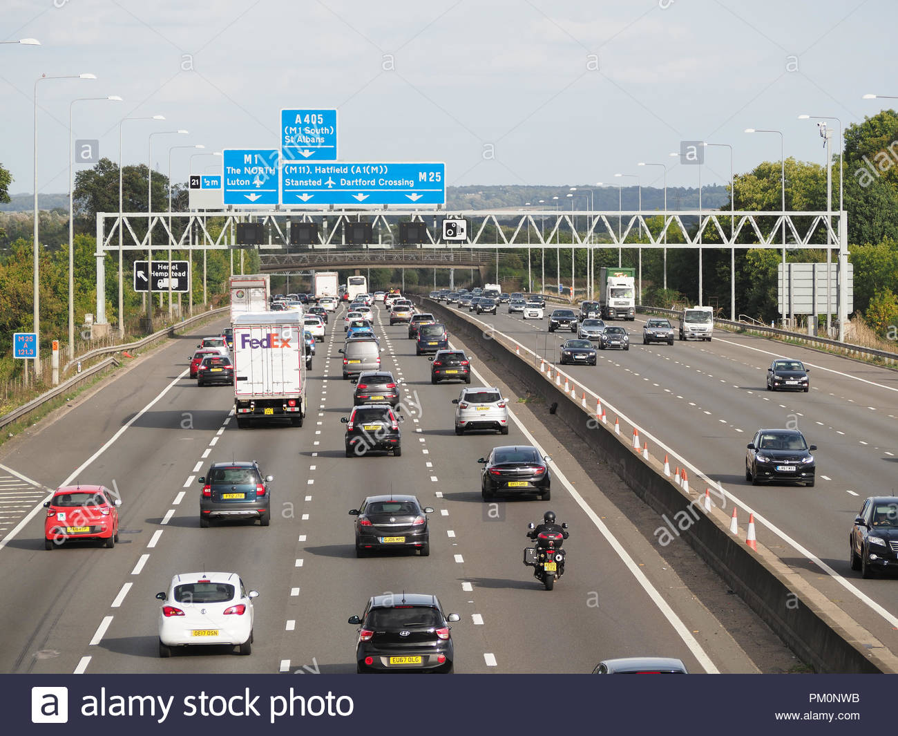 View looking down on traffic on the M25 London orbital motorway near junction 21 in Hertfordshire - Stock Image
