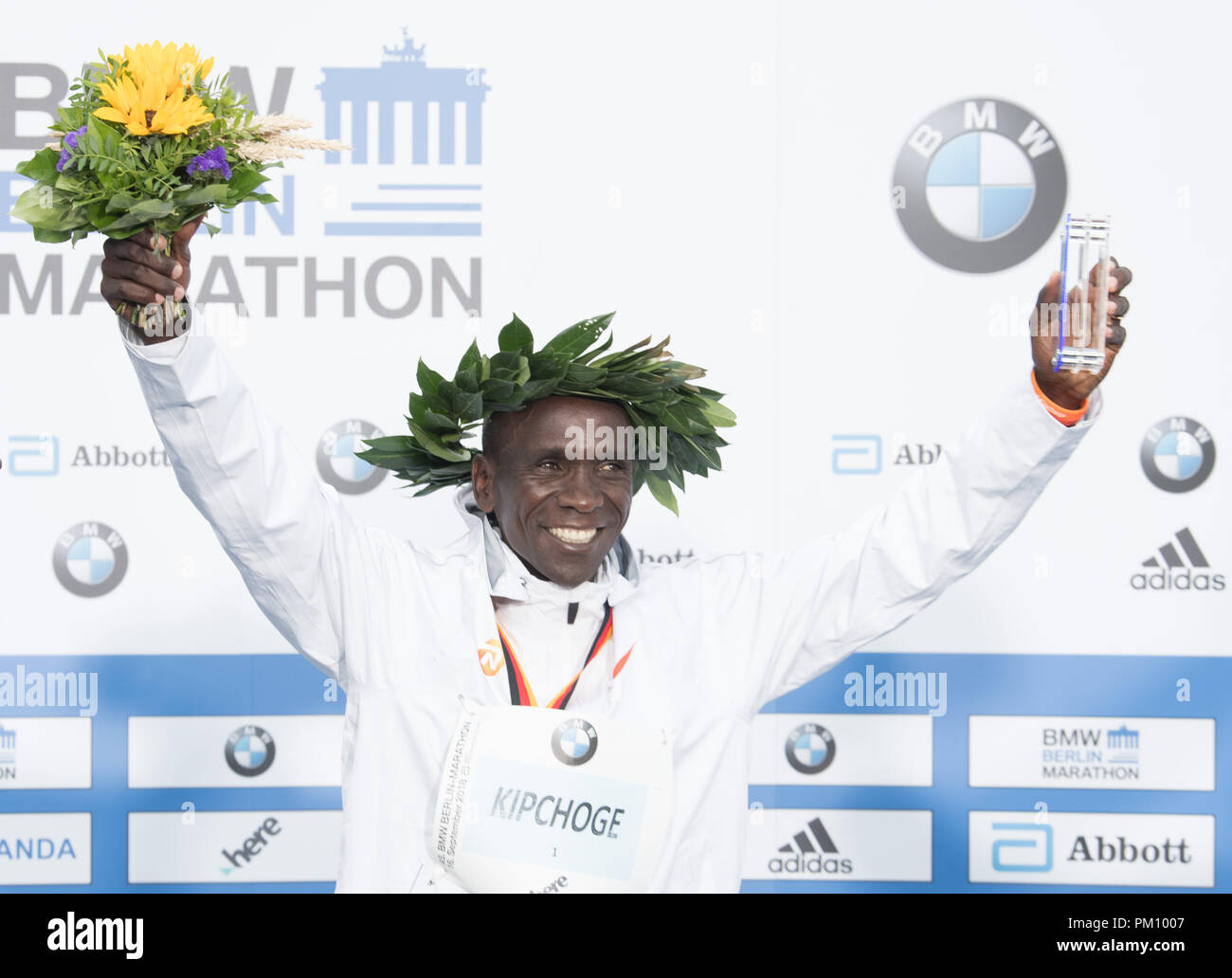 Berlin, Germany. 16 September 2018, Berlin: Kenyan Eliud Kipchoge happy about his victory in world record time of 2:01:39 during the award ceremony of the 45th BMW Berlin Marathon. Photo: Soeren Stache/dpa Credit: dpa picture alliance/Alamy Live News - Stock Image
