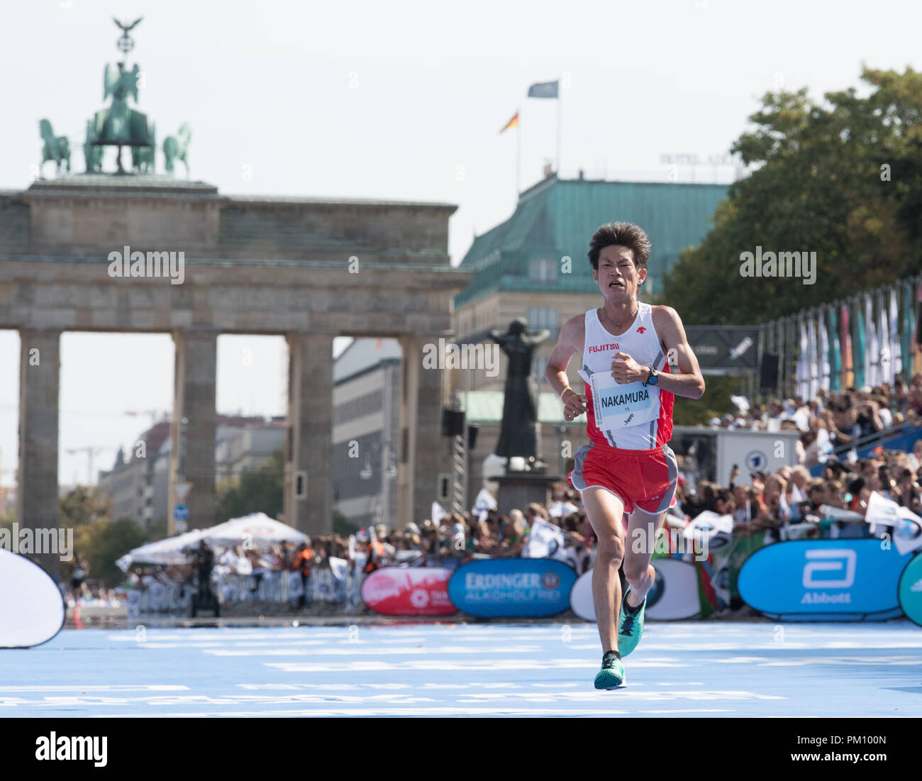 Berlin, Germany. 16 September 2018, Berlin: Shogo Nakamura from Japan finishing the 45th BMW Berlin Marathon in fourth place in 2:08.16. Photo: Soeren Stache/dpa Credit: dpa picture alliance/Alamy Live News - Stock Image