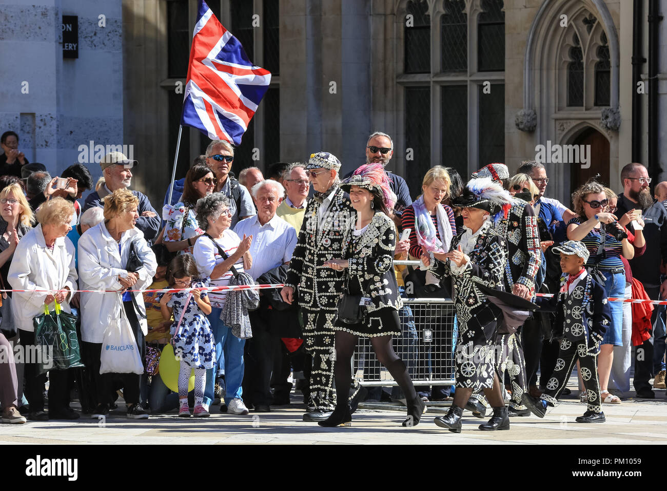 Guildhall Yard, London, UK,16th Sep 2018. The 20th anniversary of the annual Pearly Kings and Queens Harvest Festival sees the pearlies in their traditional pearl button covered suits and dresses celebrating with Morris dancing, maypole dancing, the Mayors of London and marching bands at Guildhall Yard, before parading through the City of London to St Mary Le Bow Church for a service of thanksgiving. Credit: Imageplotter News and Sports/Alamy Live News - Stock Image