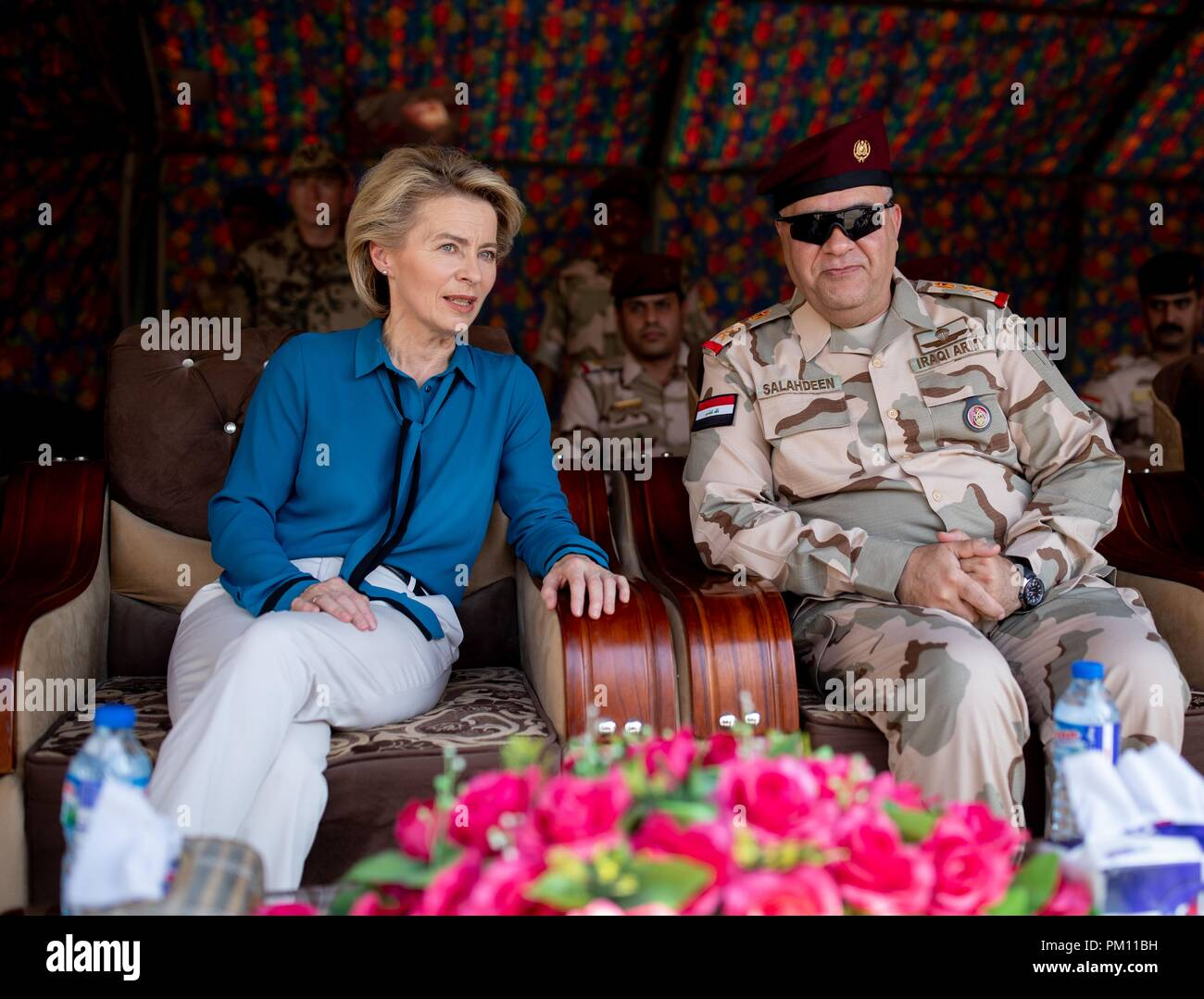 Taji, Iraq. 16th Sep, 2018. Ursula von der Leyen (CDU) and an Iraqi general observing German and Iraqi soldiers at the Iraqi military base in Taji during a CBRN defence exercise. The Minister is also in Iraq for political talks. Credit: Kay Nietfeld/dpa/Alamy Live News - Stock Image