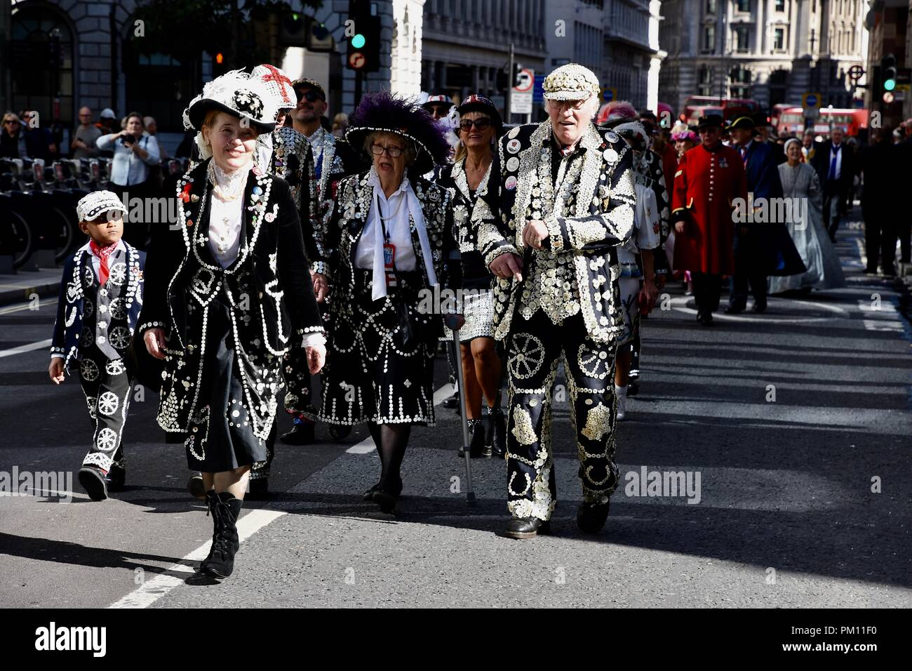 London, UK. 16th Sep, 2018. The 20th anniversary of the annual Pearly Kings and Queens Harvest Festival.The Pearlies paraded from Guildhall Yard to St Mary Le Bow Church for a service of thanksgiving.City of London.UK Credit: michael melia/Alamy Live News - Stock Image