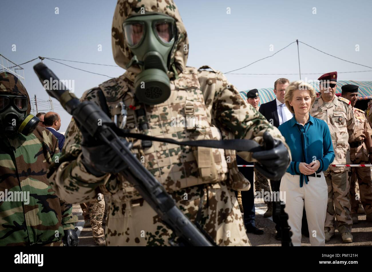 Taji, Iraq. 16th Sep, 2018. Ursula von der Leyen (CDU), German Minister of Defence, visiting German and Iraqi soldiers at a CBRN defence training centre at the Iraqi military base in Taji. The Minister is also in Iraq for political talks. Credit: Kay Nietfeld/dpa/Alamy Live News - Stock Image
