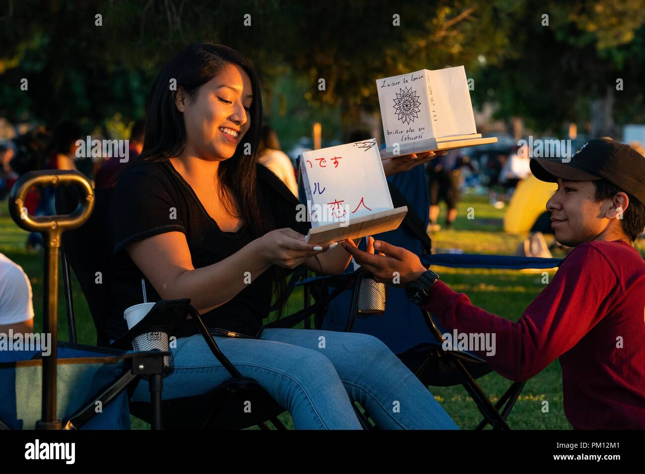 Los Angeles, USA. 15th Sep, 2018. People make water lanterns at the Water Lantern Festival in Los Angeles, the United States, Sept. 15, 2018. Credit: Qian Weizhong/Xinhua/Alamy Live News Stock Photo