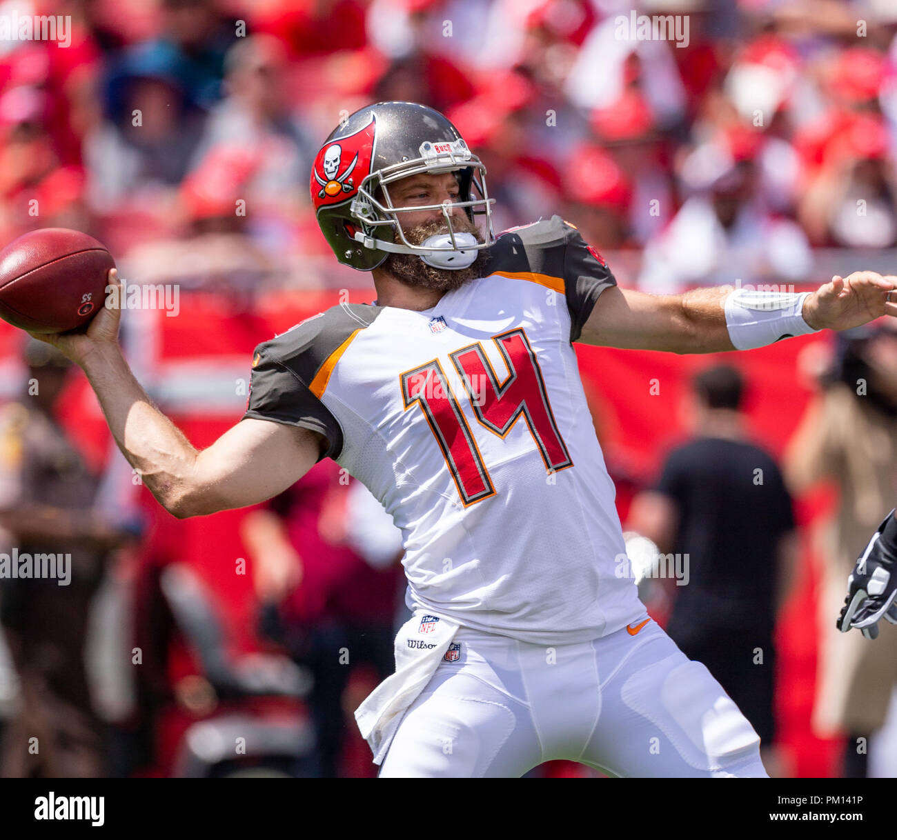 Tampa, Florida, USA. 16th Sep, 2018. Tampa Bay Buccaneers quarterback Ryan Fitzpatrick (14) first play of the game, throws a pass to Tampa Bay Buccaneers wide receiver DeSean Jackson (11) for a touchdown during the game between the Philadelphia Eagles and the Tampa Bay Buccaneers at Raymond James Stadium in Tampa, Florida. Del Mecum/CSM/Alamy Live News Stock Photo