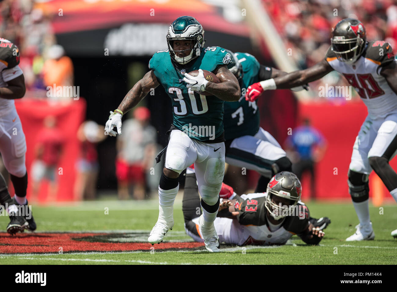 Tampa, Florida, USA. 16th Sep, 2018. Philadelphia Eagles running back Corey Clement (30) carries the ball during the first quarter against the Tampa Bay Buccaneers at Raymond James Stadium on Sunday September 16, 2018 in Tampa, Florida. Credit: Travis Pendergrass/ZUMA Wire/Alamy Live News - Stock Image