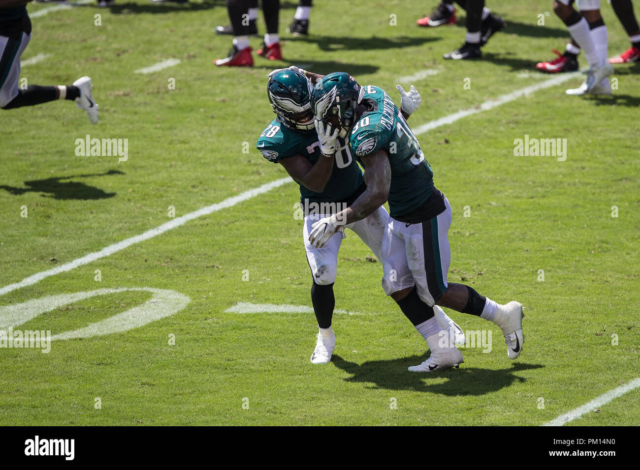 Tampa, Florida, USA. 16th Sep, 2018. Philadelphia Eagles running back Corey Clement (30) celebrates with running back Wendell Smallwood (28) after a touchdown during the second quarter against the Tampa Bay Buccaneer at Raymond James Stadium on Sunday September 16, 2018 in Tampa, Florida. Credit: Travis Pendergrass/ZUMA Wire/Alamy Live News - Stock Image