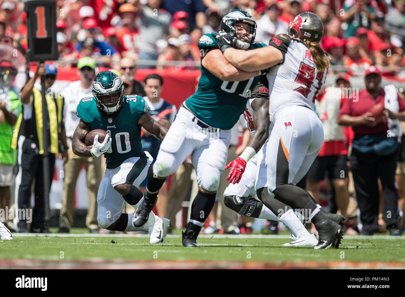 Tampa, Florida, USA. 16th Sep, 2018. Philadelphia Eagles running back Corey Clement (30) receives the ball for a 14 yard gain during the first quarter against the Tampa Bay Buccaneers at Raymond James Stadium on Sunday September 16, 2018 in Tampa, Florida. Credit: Travis Pendergrass/ZUMA Wire/Alamy Live News - Stock Image