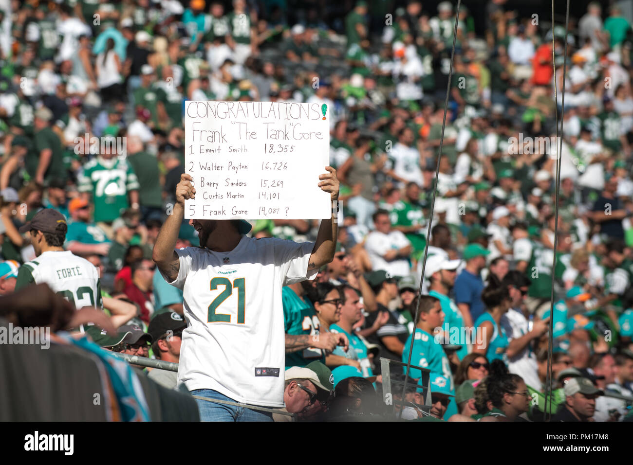 East Rutherford, NJ, USA. 16th Sep, 2018. A fan congratulates Miami Dolphins running back Frank Gore (21) (not pictured) for becoming 5th all time in rushing yards during the game between The New York Jets and The Miami Dolphins at Met Life Stadium in East Rutherford, NJ. The Miami Dolphins defeat The New York Jets 20-12. Mandatory Credit: Kostas Lymperopoulos/CSM/Alamy Live News - Stock Image