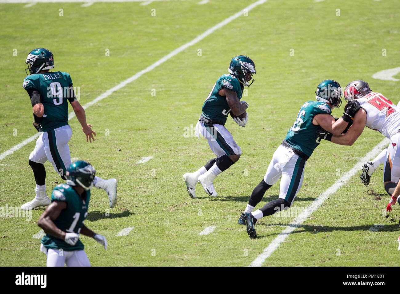 Tampa, Florida, USA. 16th Sep, 2018. Philadelphia Eagles running back Corey Clement (30) takes a handoff from quarterback Nick Foles (9) during the game against Tampa Bay Buccaneers at Raymond James Stadium on Sunday September 16, 2018 in Tampa, Florida. Credit: Travis Pendergrass/ZUMA Wire/Alamy Live News - Stock Image