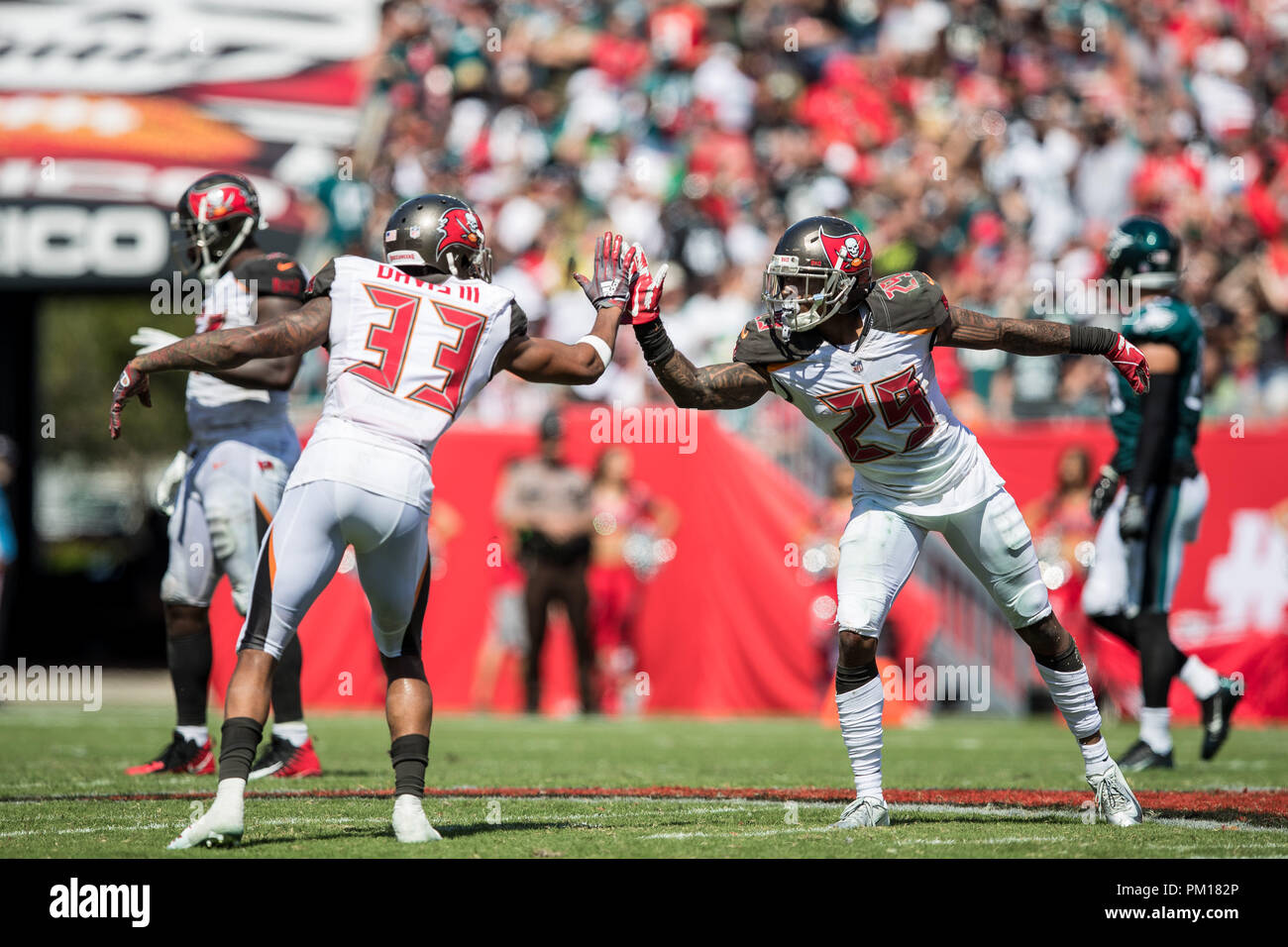 Tampa, Florida, USA. 16th Sep, 2018. Tampa Bay Buccaneers cornerback Ryan Smith (29) celebrates with cornerback Carlton Davis (33) after a broken up pass intended for the Philadelphia Eagles at Raymond James Stadium on Sunday September 16, 2018 in Tampa, Florida. Credit: Travis Pendergrass/ZUMA Wire/Alamy Live News Stock Photo