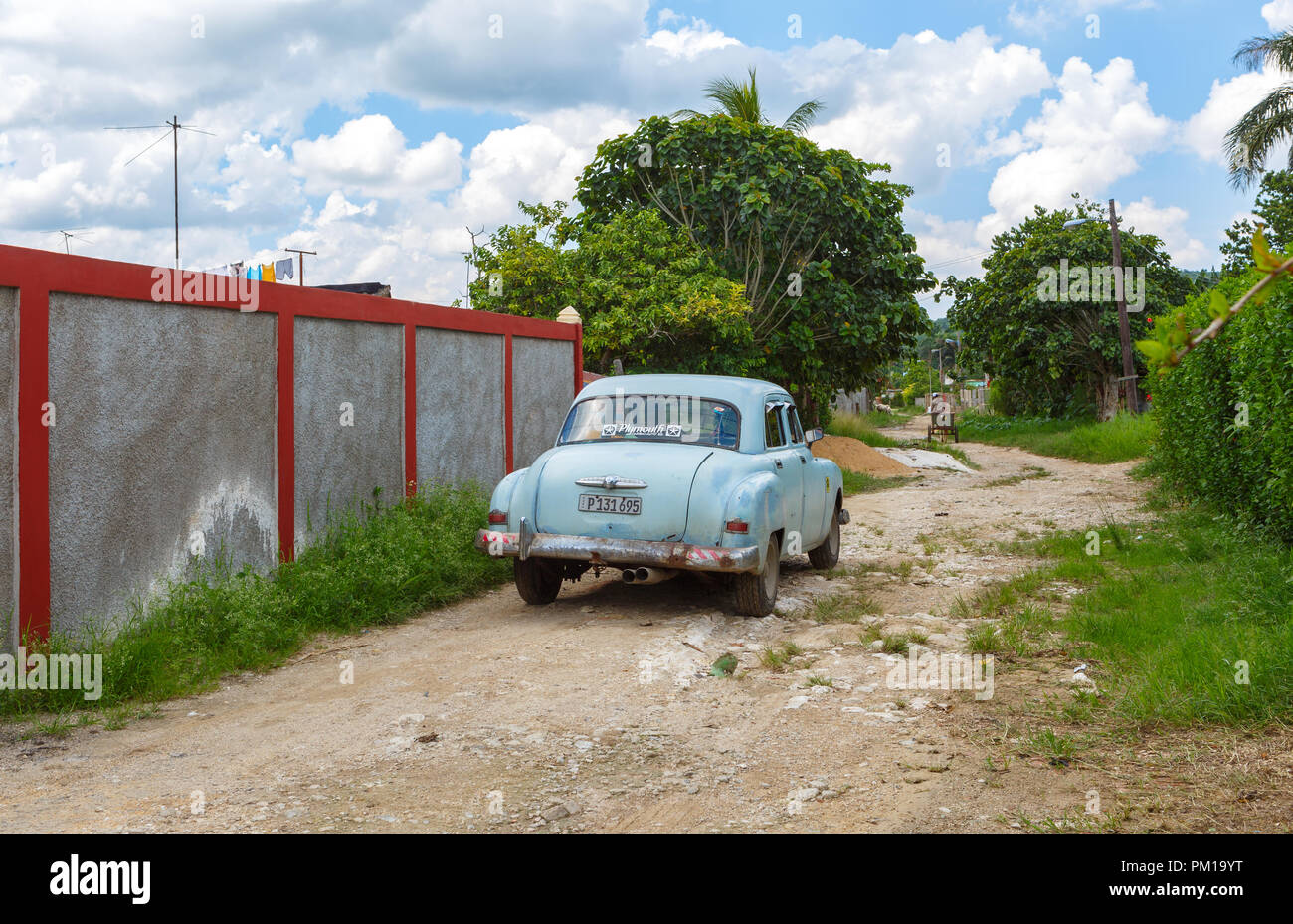 Antique car on a rough road in the province of Mayabeque Cuba on August 25, 2018 - Stock Image