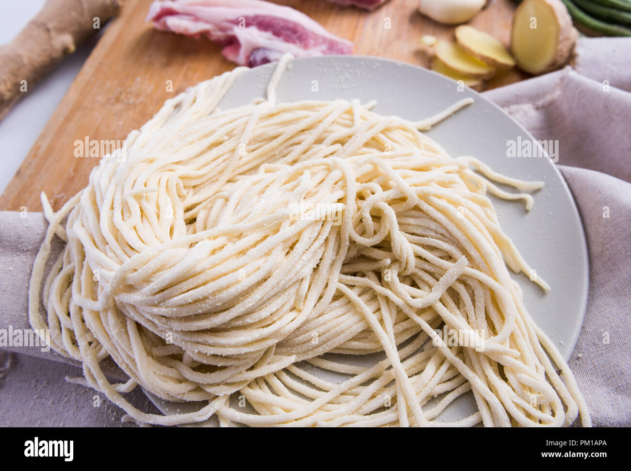 Chinese pasta, fresh noodles and meat, and other vegetables - Stock Image