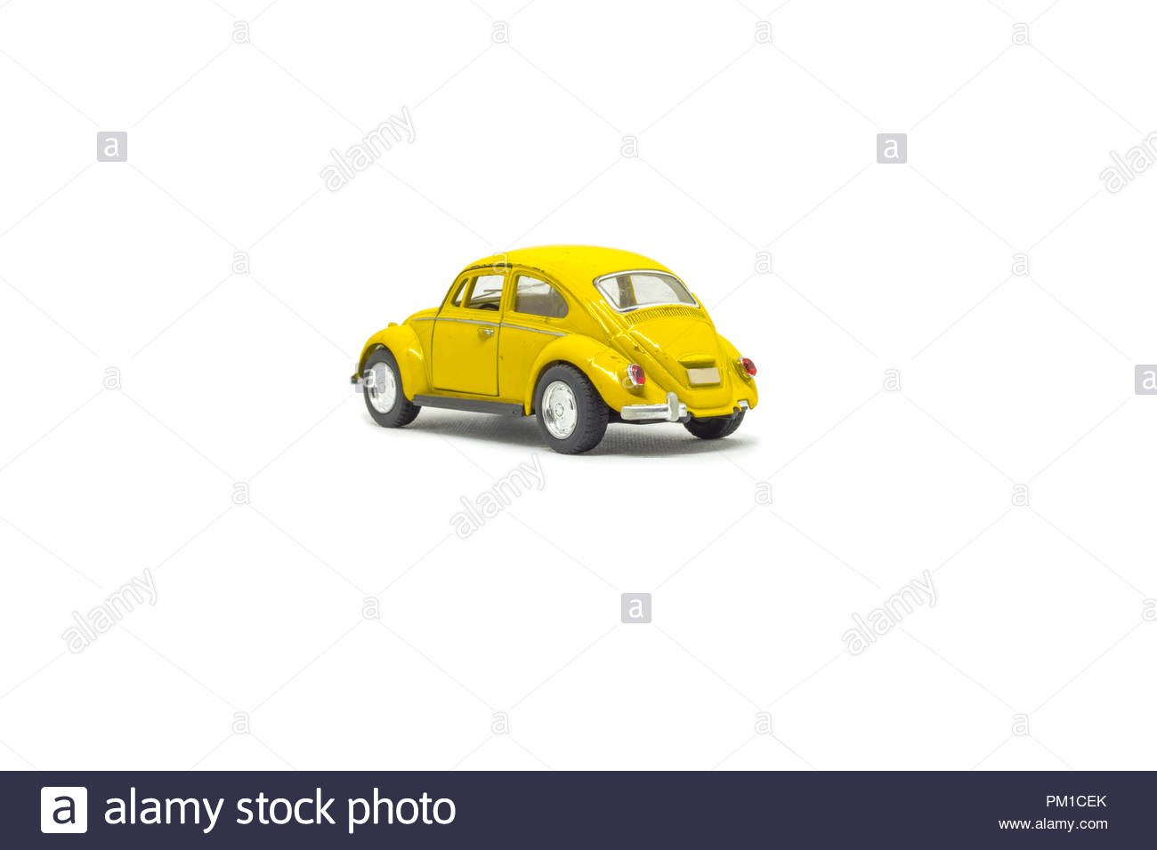Isolated used yellow toy car, rear view - Stock Image