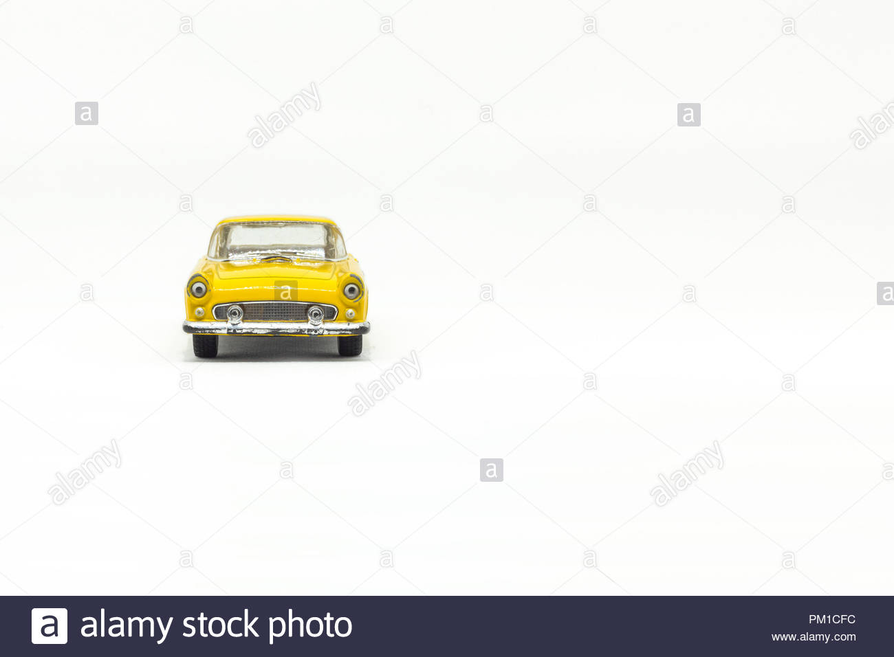 Used yellow american toy car, front view - Stock Image