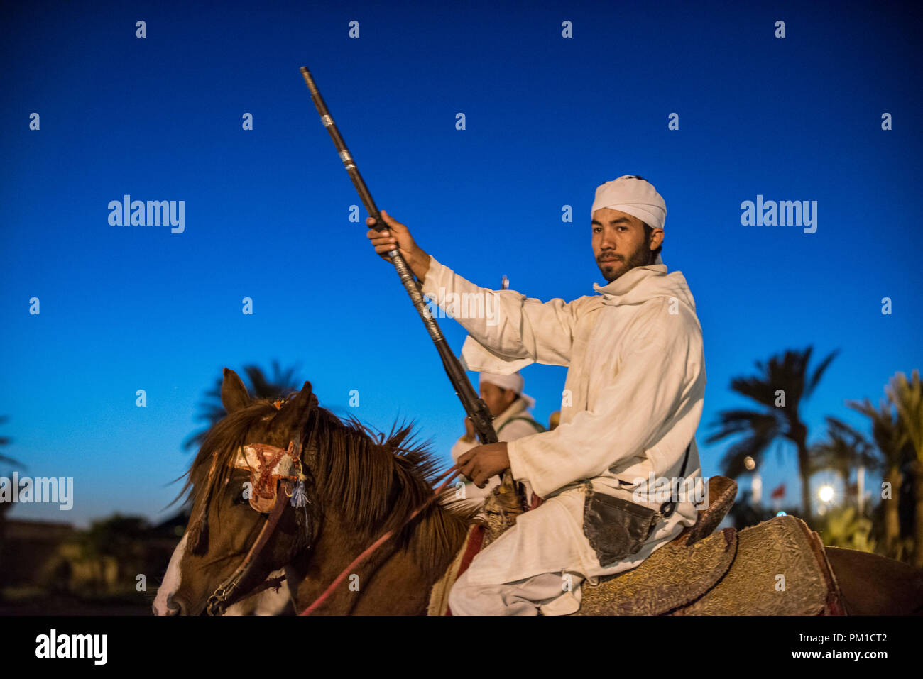 26-02-15, Marrakech, Morocco. Man in traditional dress on horseback with gun at the tourist attraction of Fantasia / Chez Ali. Photo © Simon Grosset - Stock Image