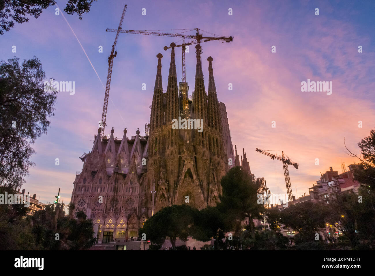 La Sagrada Familia Catholic Church in the Catalan City of Barcelona, Spain.  Designed by Antoni Gaudi the Basilica is still under construction today. Stock Photo