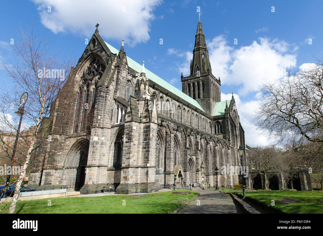 St Mungo's cathedral in Glasgow, Scotland, on a beautiful sunny winter day. No trees have any leaves owing to the time of year. - Stock Image