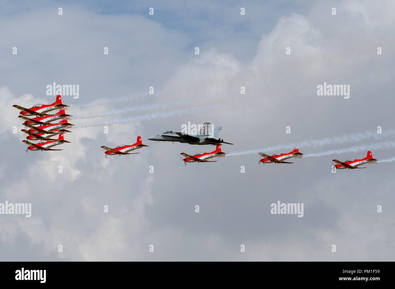 FAIRFORD, UK, JULY 13 2018: A photograph documenting Swiss Air Force Swiss Air Force McDonnell Douglas F/A-18C Hornet, and the PC7 Display Team in for - Stock Image