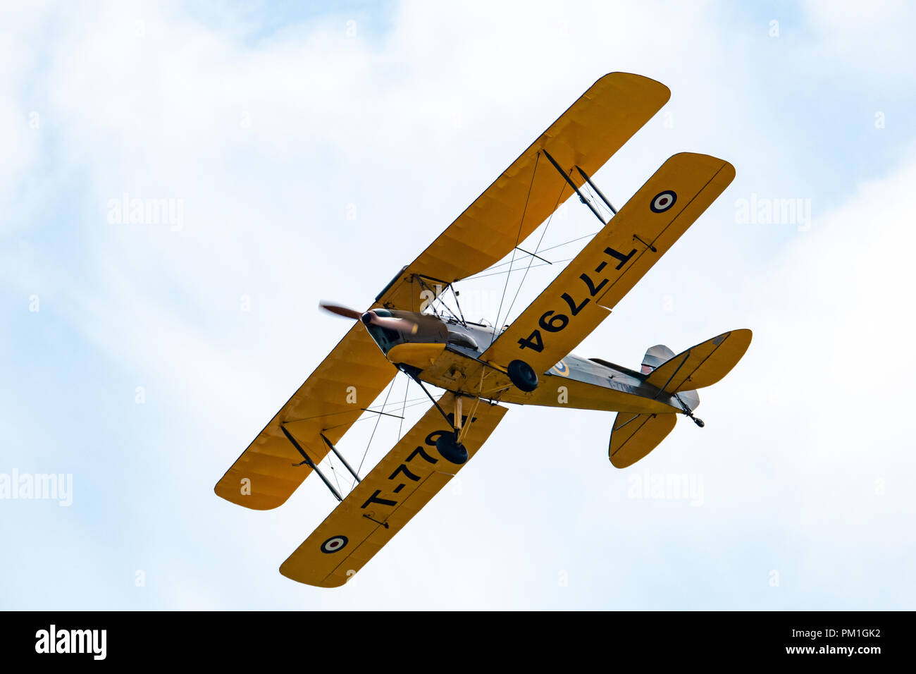 TELFORD, UK, JUNE 10, 2018 - A photograph documenting a lone DH.82 Tiger Moth Trainer aircraft at RAF Cosford as part of the RAF 100 Centenary air sho - Stock Image