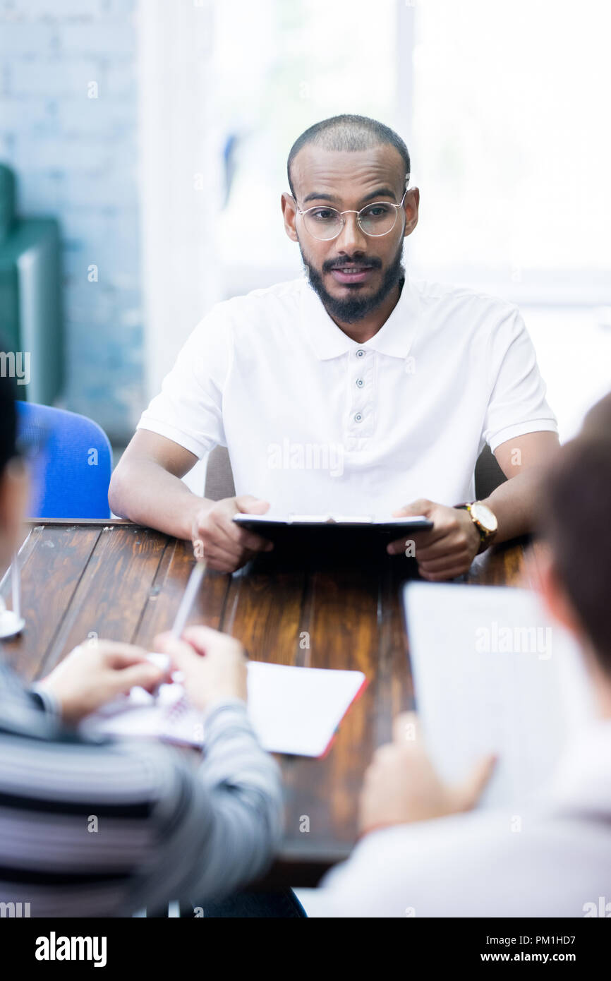 Young man at job interview - Stock Image