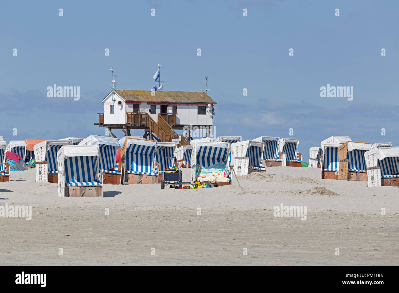 stilt house and beach chairs, St. Peter-Ording, Schleswig-Holstein, Germany - Stock Image