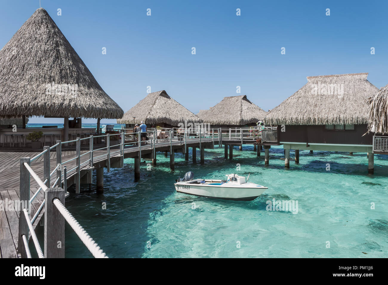 Over water bungalow and a boat in Moorea, French Polynesia Stock Photo