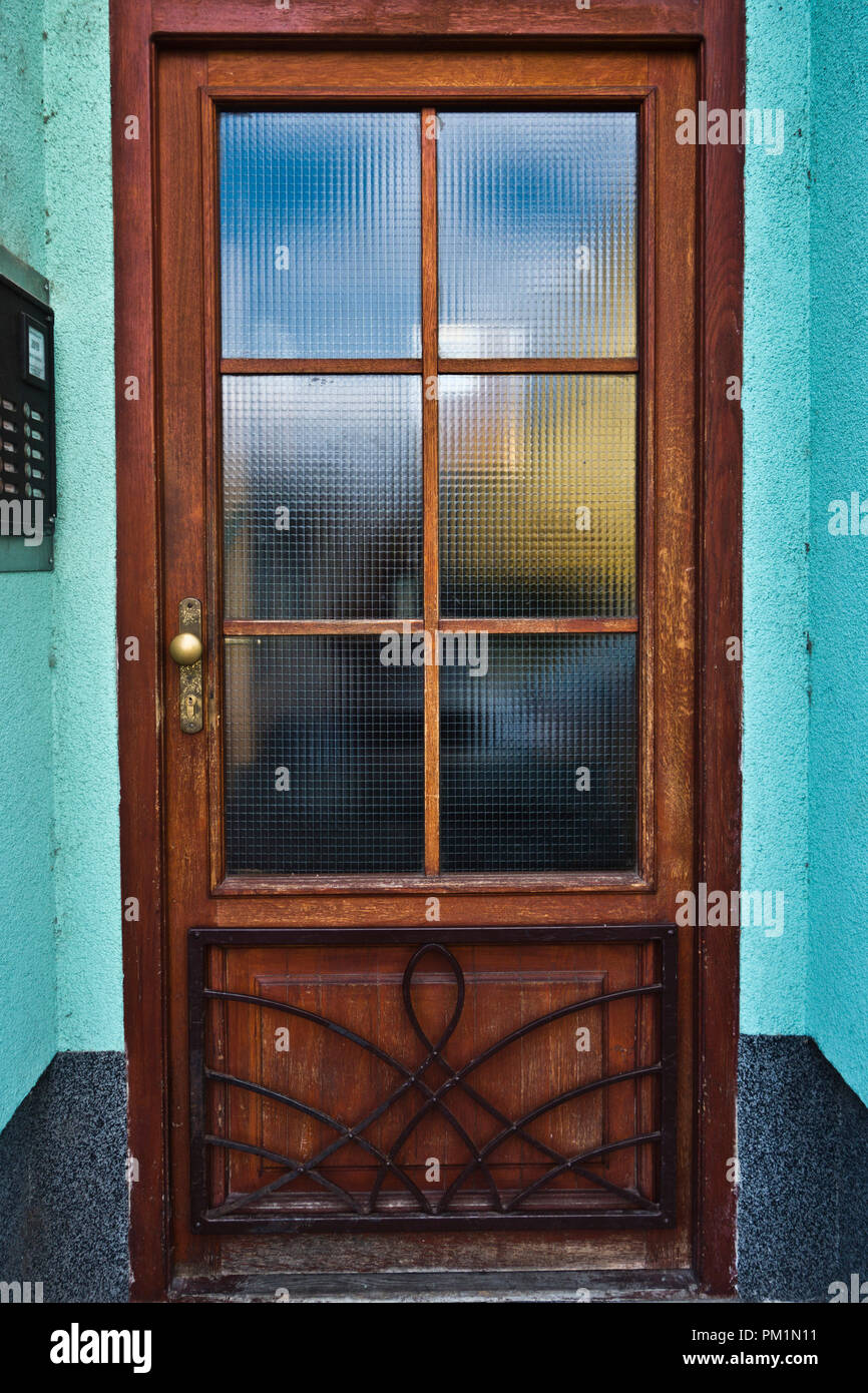 brown wood framed door with glass - Stock Image