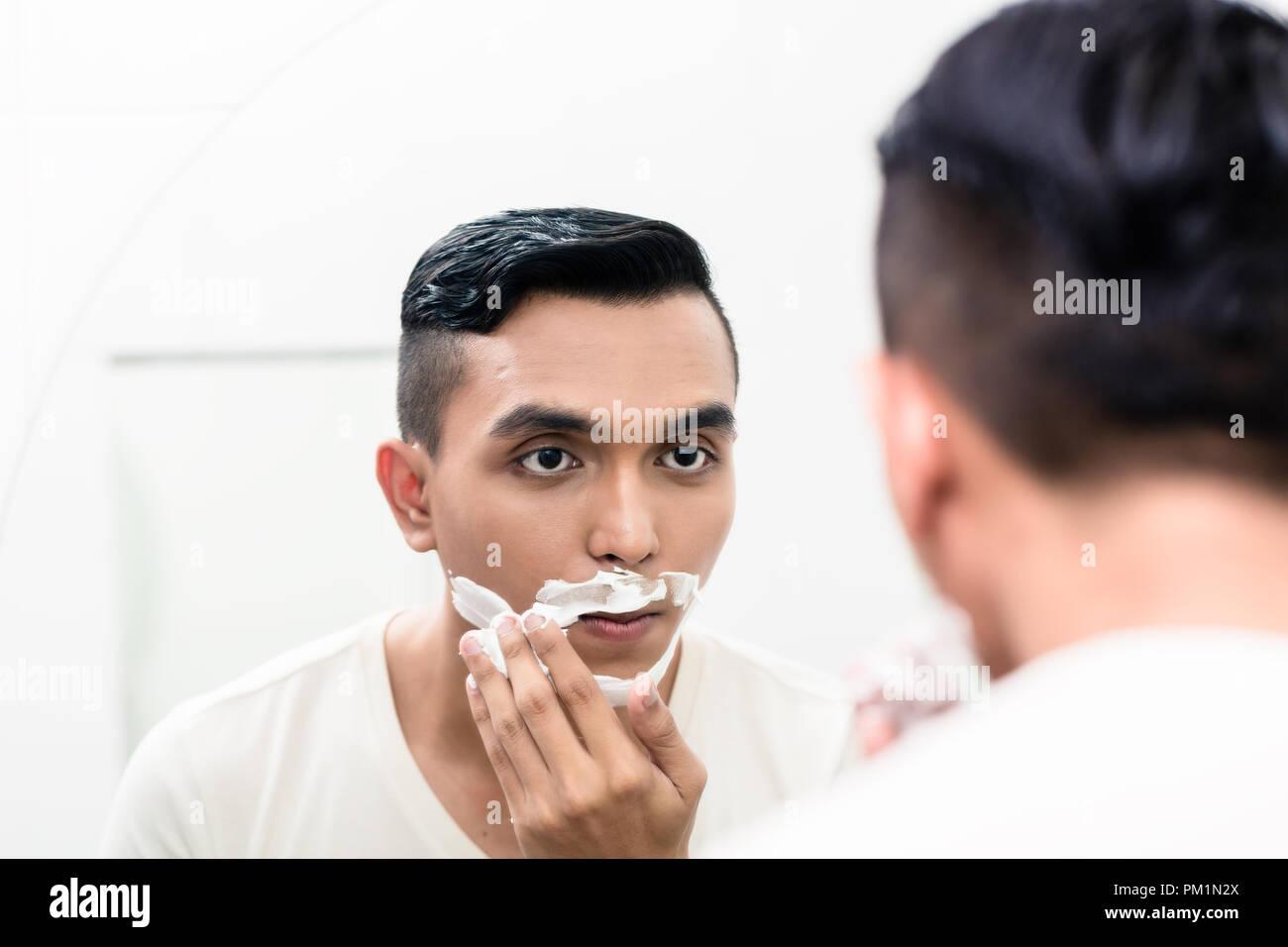 Man applying shaving foam - Stock Image