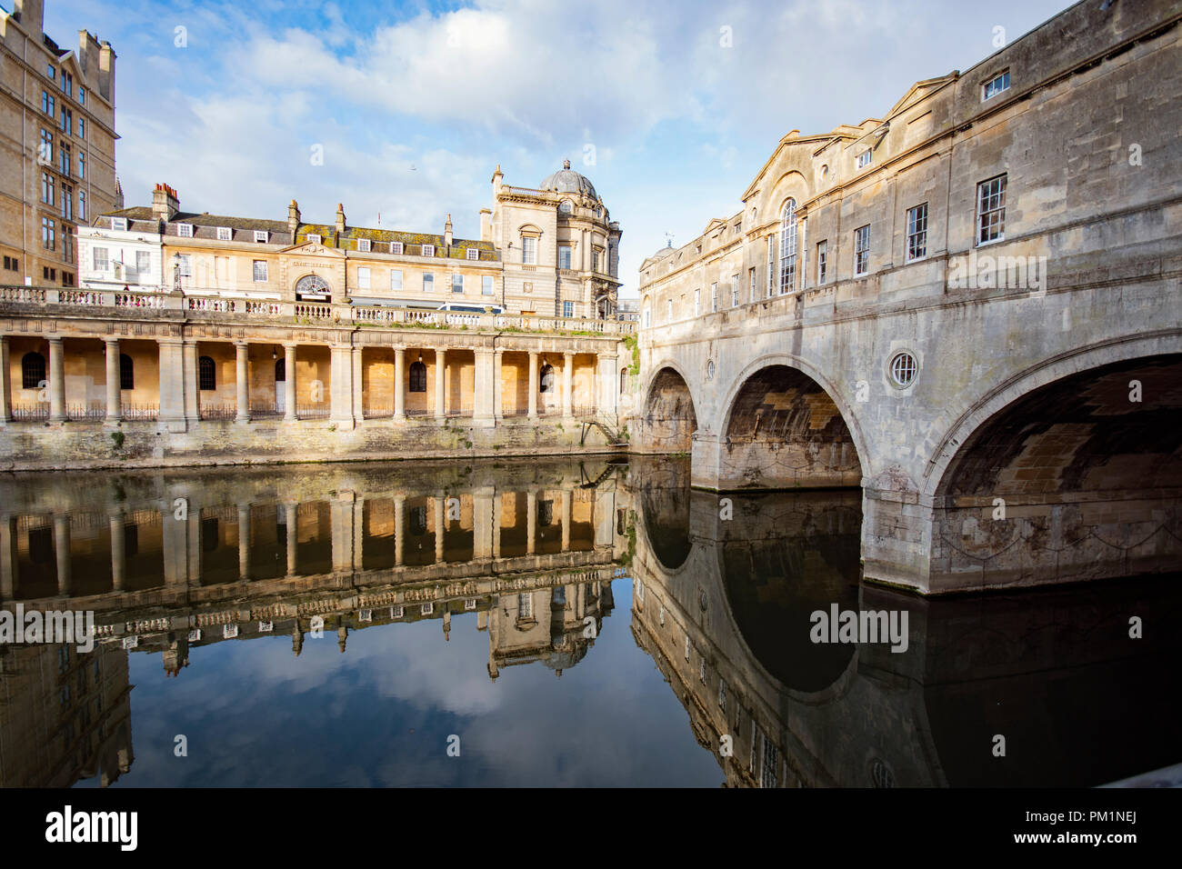 Views of Pultney Bridge in Bath, on a beautiful day with clear reflections in the water - Stock Image