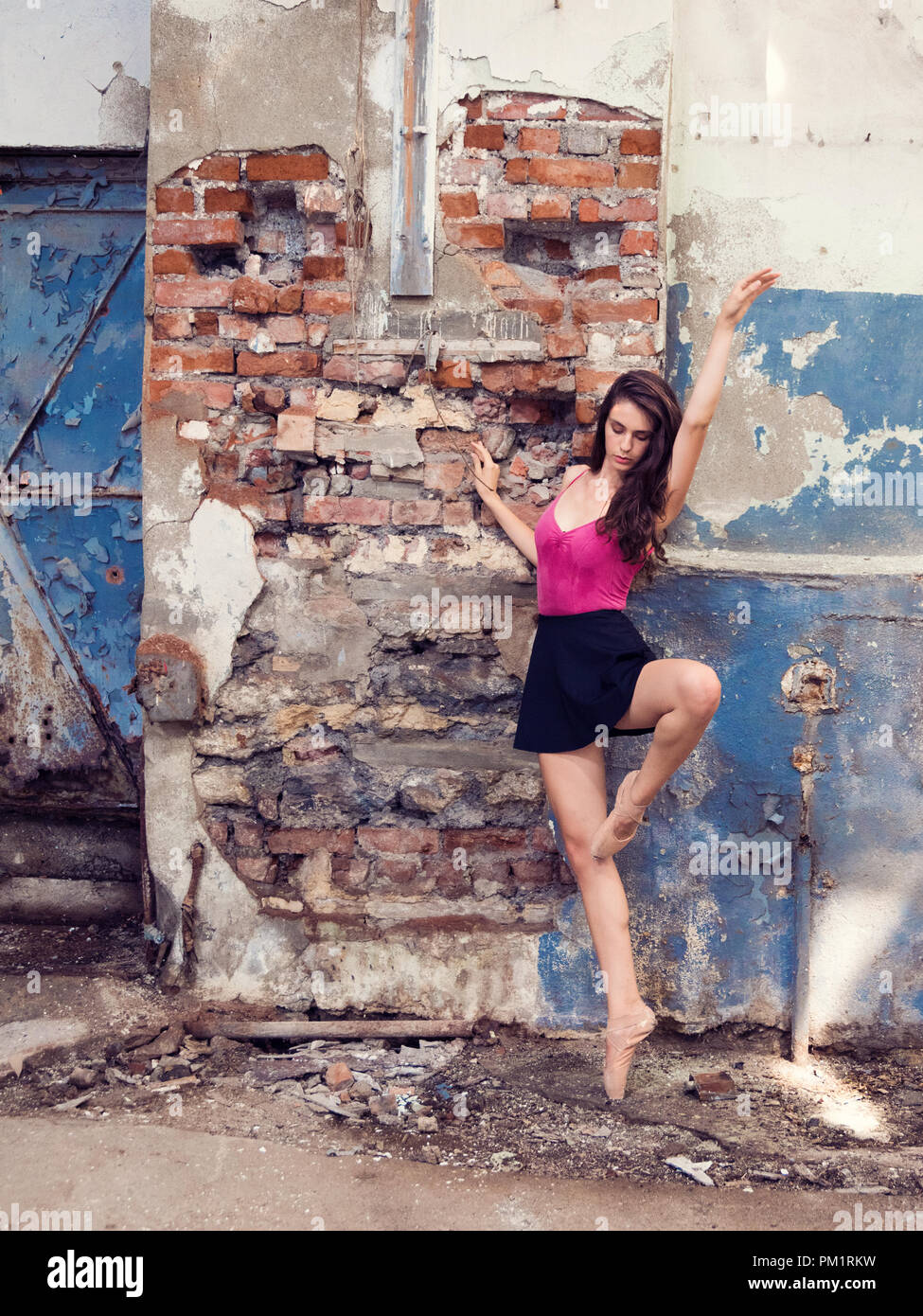 Girl on pointe against old wall, Istanbul - Stock Image