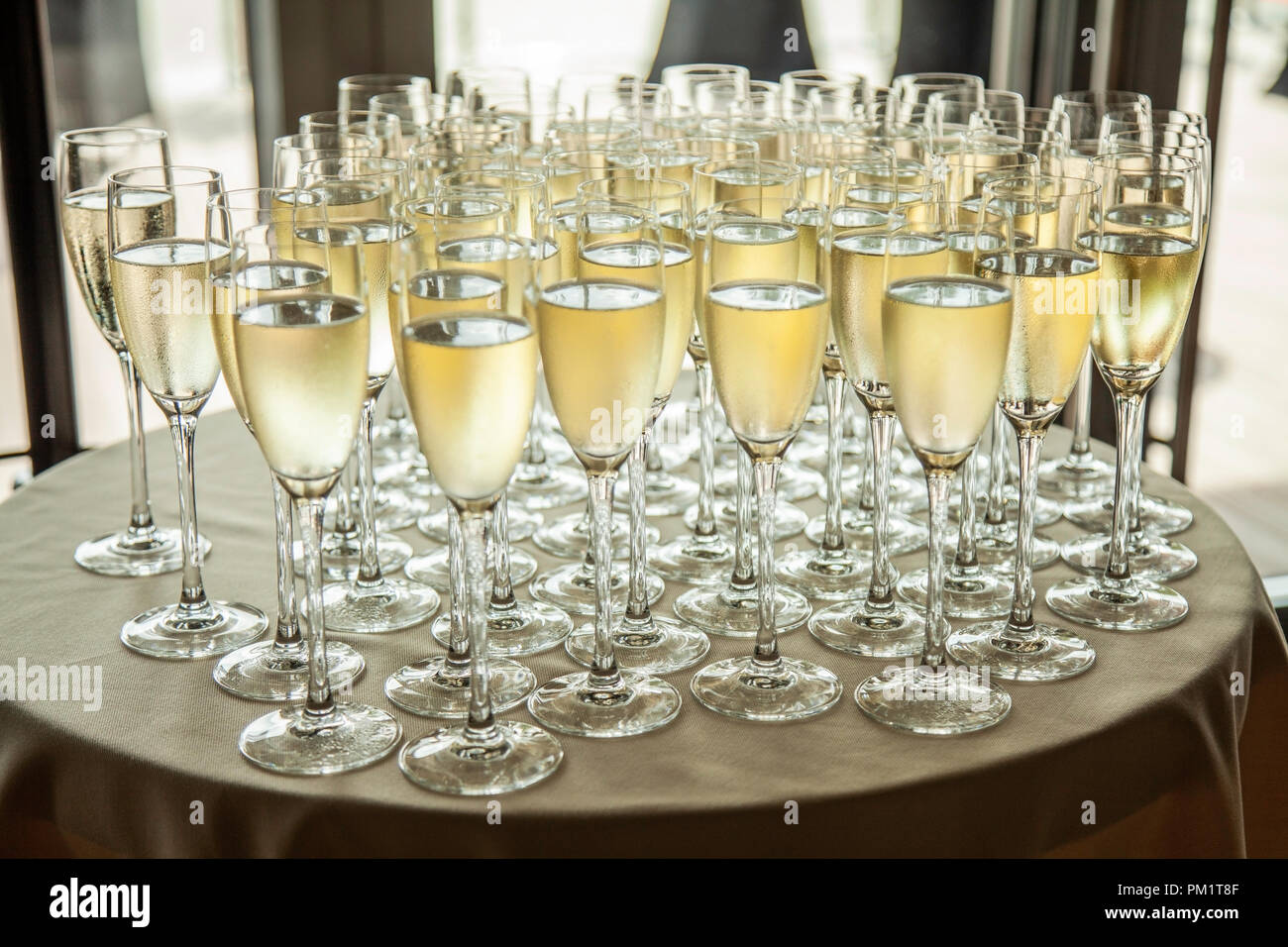 Glasses with cold champagne at the banquet - Stock Image